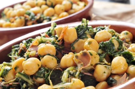 typical: spanish espinacas con garbanzos, spinach with chickpeas, served as tapas Stock Photo