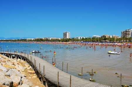 Salou, Spain - August 10, 2012: Vacationers in Llevant Beach in Salou, Spain. Salou is a major destination for sun and beach for European tourism with more than 50,000 accommodations Stock Photo - 17118437