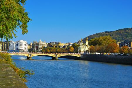 san sebastian: view of Maria Cristina Bridge and Urumea River in San Sebastian, Spain, in autumn