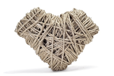 heart-shaped coil of rope on a textured background Stock Photo - 17127274