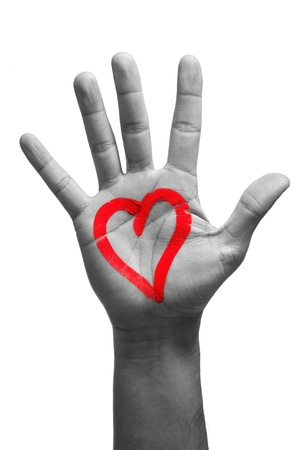 a man palm hand with a heart painted in red on it, on a white background Stock Photo - 17127284