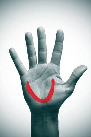 a man palm hand with a smiling mouth painted in red on it Stock Photo - 17127269