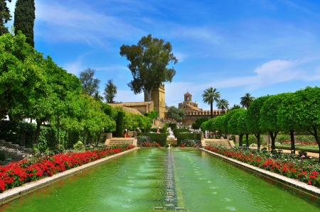 homage: Cordoba, Spain - May 16, 2012: Gardens of Alcazar de los Reyes Cristianos in Cordoba, Spain. Alcazar has 55,000 square meters of gardens full of vegetation surrounded by fountains and ponds