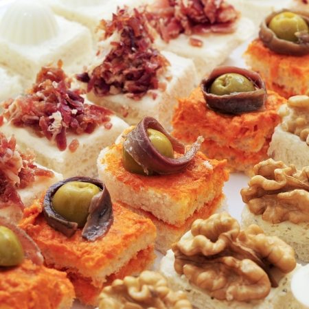 canapes: closeup of a pile of different canapes