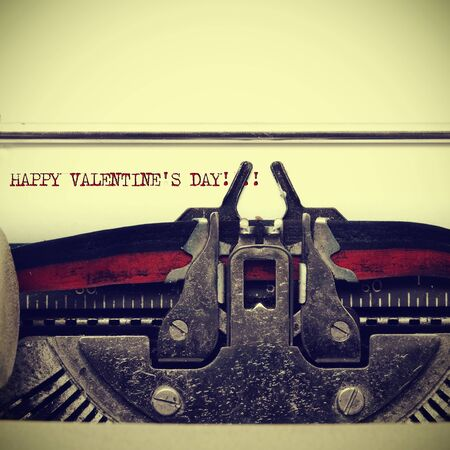 sentence happy valentines day written on an old typewriter, with a retro effect photo