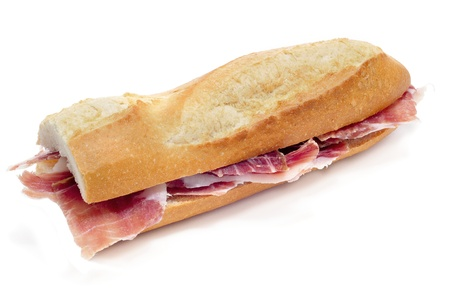 cured: closeup of a spanish serrano ham sandwich on a white background