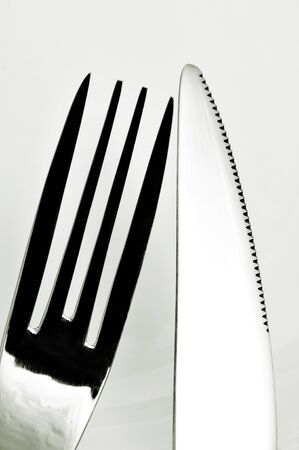 closeup of a knife and a fork on a white tablecloth Stock Photo - 17235514