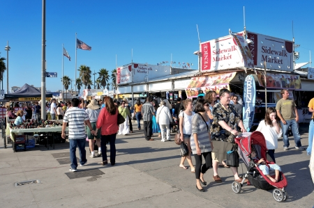 Venice, US - October 17, 2011: Crowd in Ocean Front Walk of Venice Beach in Venice, US. This boardwalk is 2.5 kilometer long and is full of stores and stalls