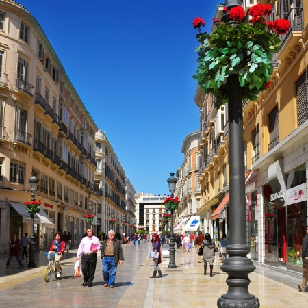 main street: Malaga, Spain - March 12, 2012: Calle Larios in Malaga, Spain. This 300 meters long street is the main commercial street of the city and the fifth most expensive shopping street in Spain