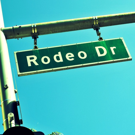 a Rodeo Drive sign over the blue sky, in Beverly Hills, US photo