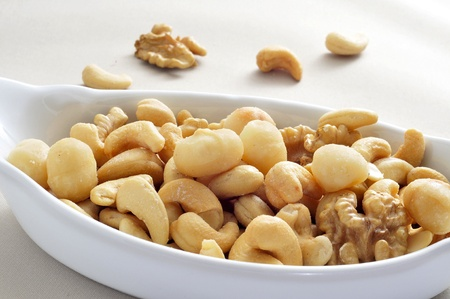 energy mix: a bowl with mixed nuts, such as walnuts, macadamia nuts and cashews