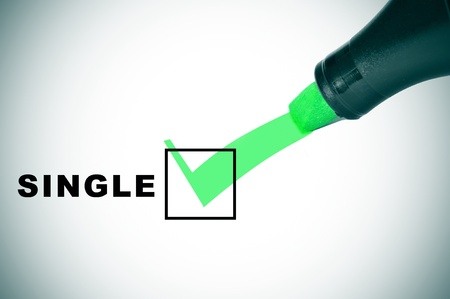 unmarried: a check mark drawn with a green marker pen on a checbox with the word single