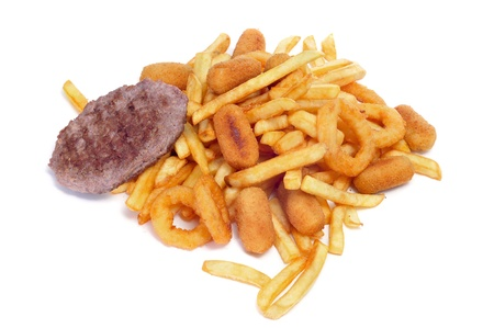 fattening: closeup of a pile of fried and fattening food on a white background