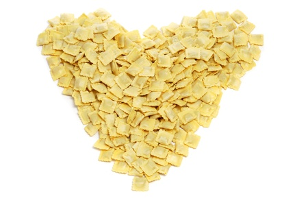 a pile of tortellini forming a heart on a white background photo