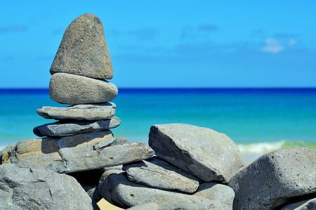 karesansui: closeup of a stack of stones on a tropical beach