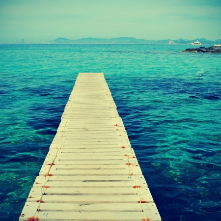 boardwalk in Ses Illetes Beach in Formentera, Balearic Islands photo
