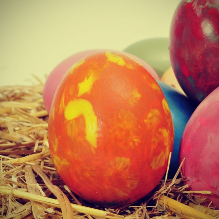 some easter eggs of different colors on a nest, with a retro effect photo
