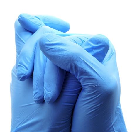 handschuhe: jemand tr�gt ein Paar blaue OP-Handschuhe Lizenzfreie Bilder