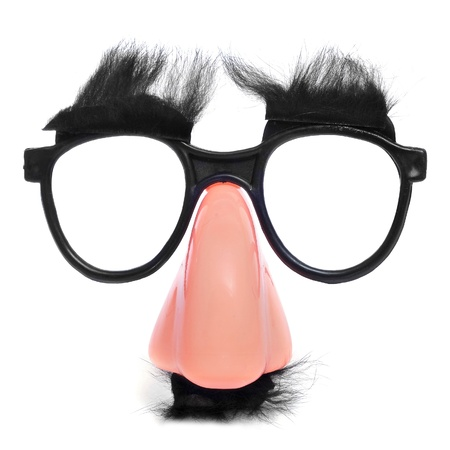 funny glasses: closeup of a fake nose and glasses, with mustache and furry eyebrows