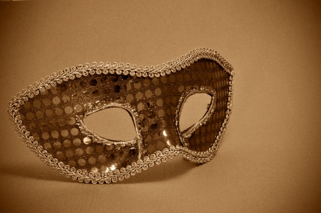 a carnival mask on a brown background photo