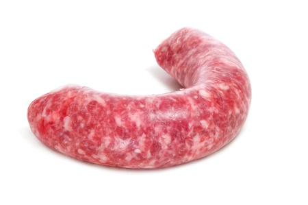 llonganissa: closeup of a raw pork meat sausage on a white background