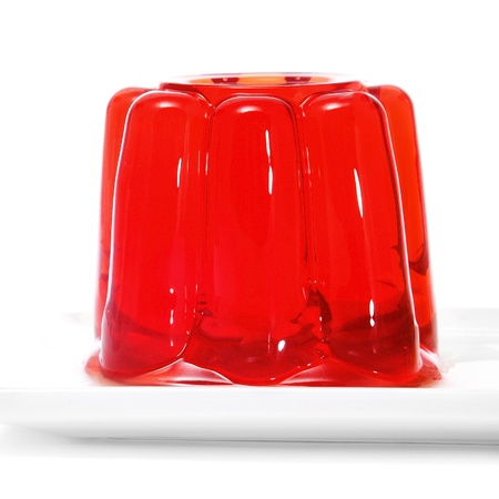 closeup of a plate with a red gelatin on a white background photo