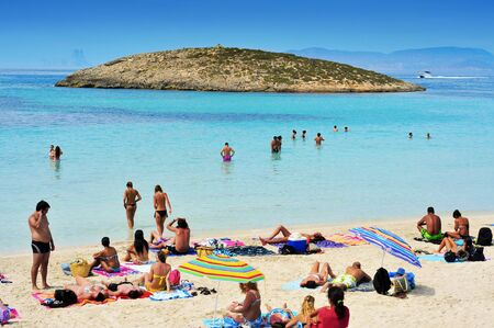 vacationers: Formentera, Spain - September 18, 2012: Ses Illetes Beach in Formentera, Balearic Islands, Spain. Formentera is renowned across Europe for many white beaches like Ses Illetes