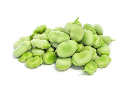 close up of a pile of raw broad beans on a white background