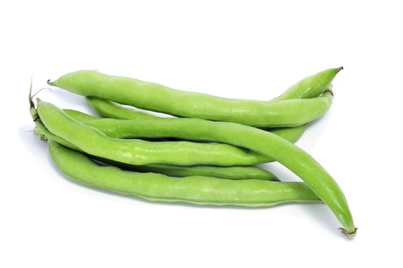 broad: closeup of some broad bean pods on a white background Stock Photo