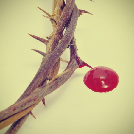 jesus blood: closeup of a representation of the crown of thorns and blood of Jesus Christ Stock Photo