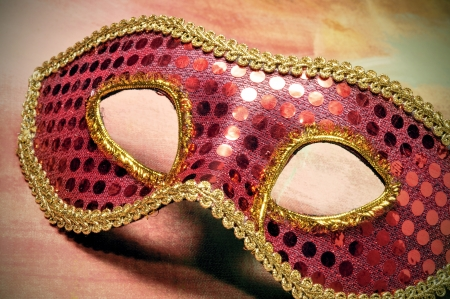 closeup of an elegant red and golden carnival mask photo