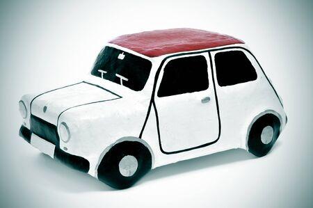 papiermache: closeup of a papier-mache toy car