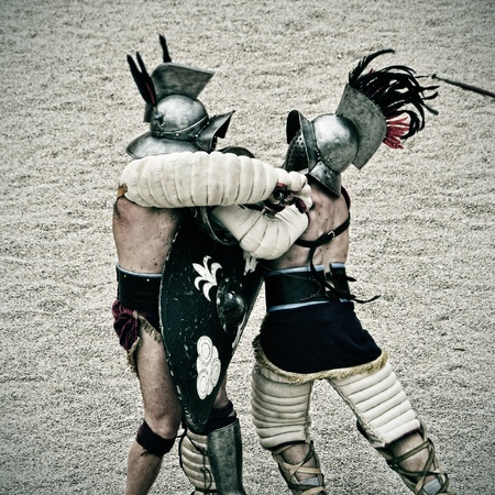 elbow pads: Tarragona, Spain - May 26, 2012: Gladiators on the arena of Roman Amphitheater in Tarragona, Spain. Every year, the historic recreation program TarracoViva recreates a gladiators fight
