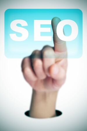 a man finger clicking on a button with the word SEO written in it on a transparent screen Stock Photo - 17681659