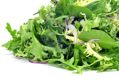 cornsalad: closeup of a pile of lettuce mix on a white background Stock Photo