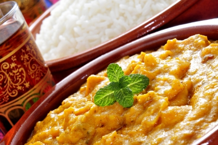 south asians: closeup of some bowls with korma curry and basmati rice