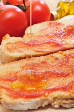 pa amb tomaquet, bread with tomato, typical of Catalonia, Spain photo