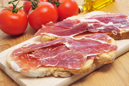 hero sandwich: pa amb tomaquet, slices of bread with tomato, with spanish serrano ham served as tapas