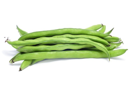broad: closeup of some broad bean pods with the beans inside on a white background