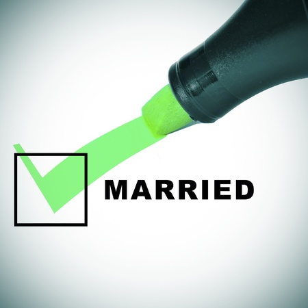 validated: a check mark drawn with a green marker pen on a checbox with the word married Stock Photo