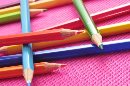 closeup of some wooden coloured pencils of different colors on a pink background Stock Photo - 17795328
