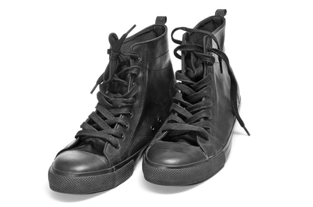 a pair of black sneaker boots on a white background Stock Photo - 17948931
