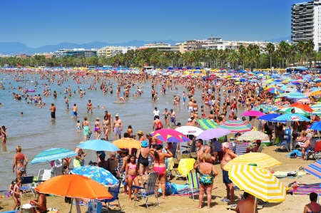 vacationers: Salou, Spain - August 10, 2012: Vacationers in Llevant Beach in Salou, Spain. Salou is a major destination for sun and beach for European tourism with more than 50,000 accommodations