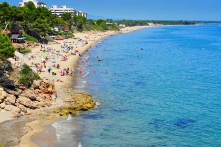 vacationers: Mont-roig del Camp, Spain - August 10, 2012: Vacationers in Miami Platja beaches in Mont-roig del Camp, Spain. One of the main attractions of Miami Platja is its 12 km of coastline