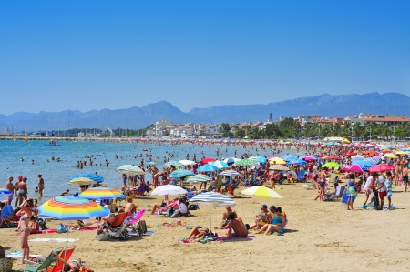 vacationers: Cambrils, Spain - August 10, 2012: Vacationers in Prat de en Fores Beach in Cambrils, Spain. This destination for sun and beach for European tourism offers more than 22,000 accommodations Editorial