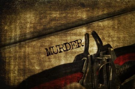 suspense: word murder written with an old typewriter