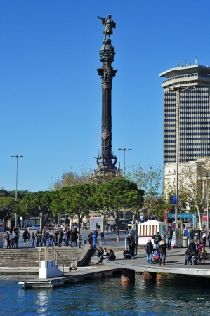 Barcelona, Spain - January 26, 2013: Columbus Monument and Port Vell in Barcelona, Spain. The monument for Christopher Columbus is a 60 meters tall structure at the end of La Rambla