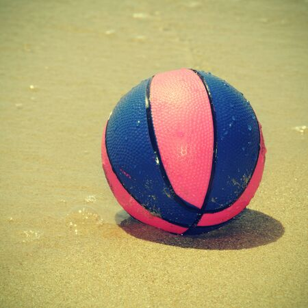 a beach ball of different colors in the seashore, with a retro effect Stock Photo - 17948983