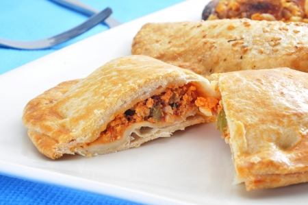 meat pie: closeup of some empanadas, a cake stuffed with vegetables and meat Stock Photo