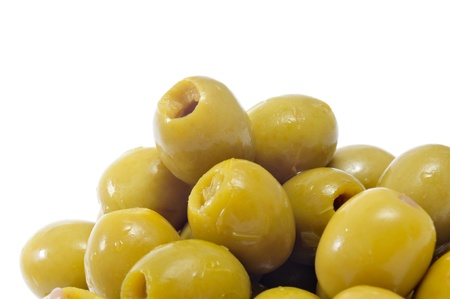 pitted: closeup a pile of spanish pitted olives on a white background